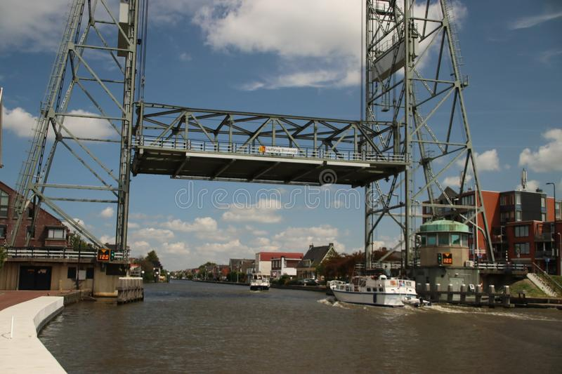 Steel vertical lifting bridge over the Gouwe Canal at Boskoop in the Netherlands, stock photo