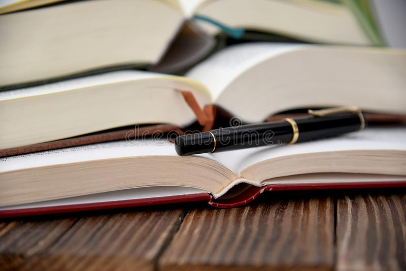 Open stocked books and feather style royalty free stock images