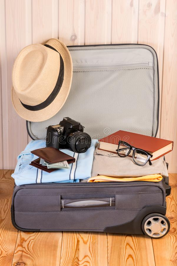 Open suitcase with a broadcaster ready. For a big trip royalty free stock images