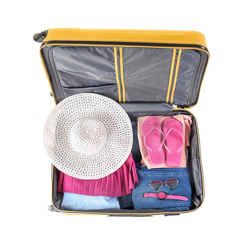 Open suitcase with packed things on white background, top view royalty free stock images