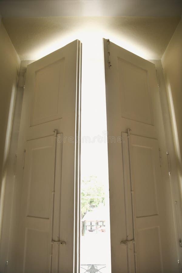 Open sunlit doors stock photo