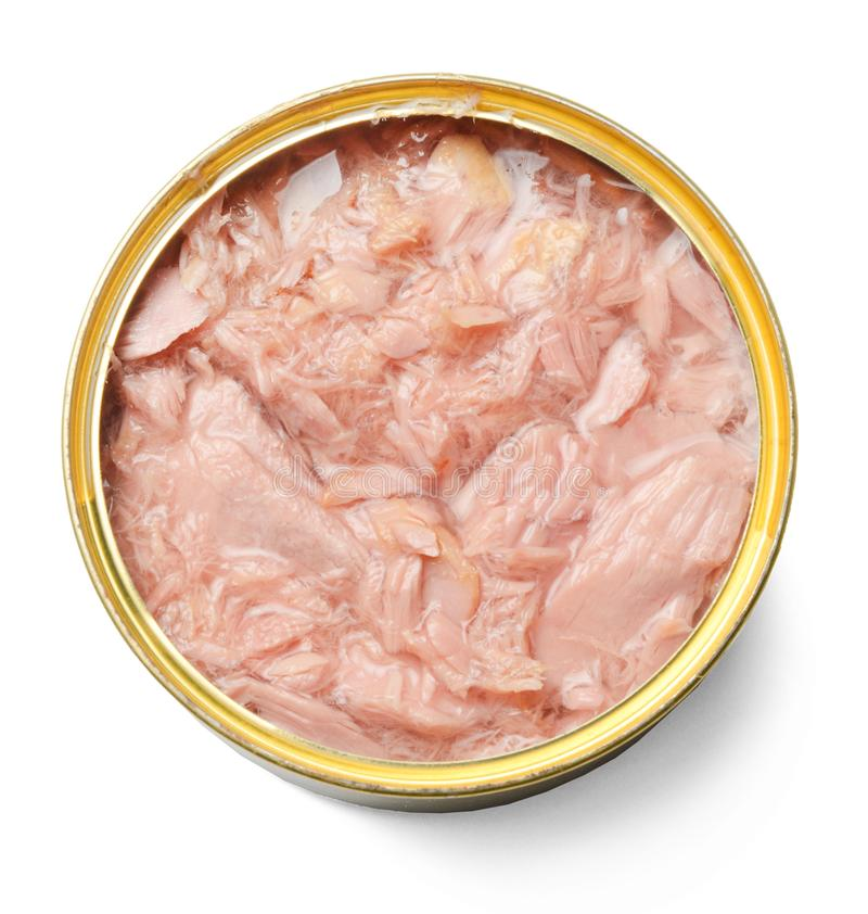 Open tin can with tuna isolated on white. Close-up. stock image
