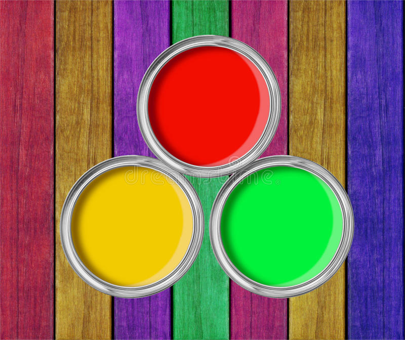 Open tin cans with paint on paint wooden background royalty free stock image