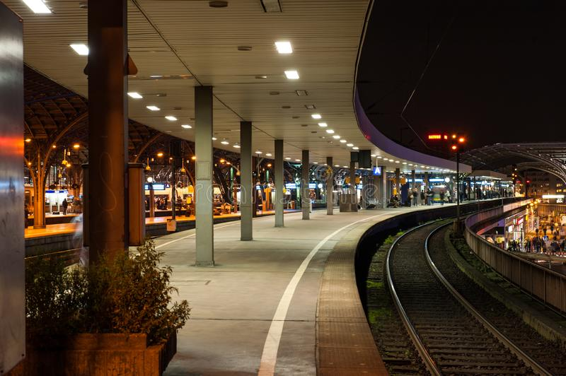 Train station at night outdoor. Open train station with roof and pillars and rails at night outdoor royalty free stock images