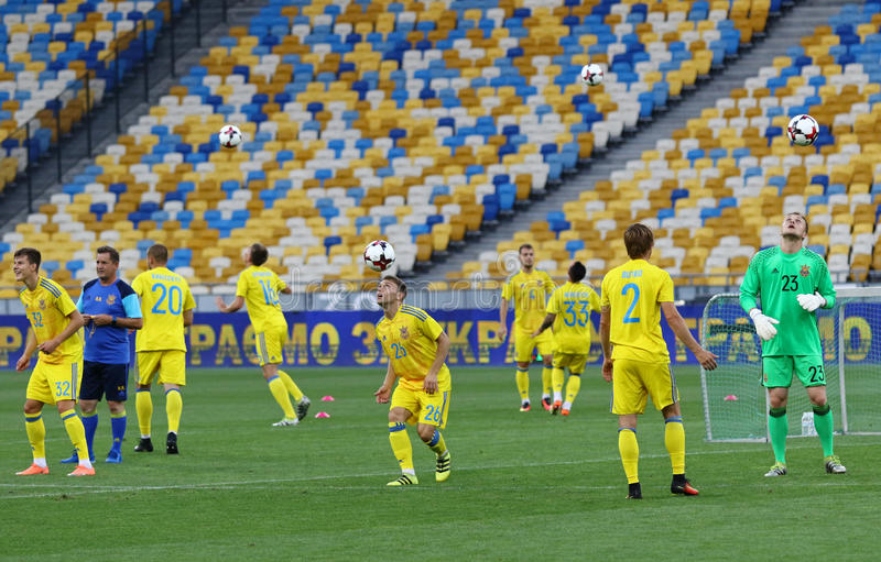 Open Training session of Ukraine National Football Team. KYIV, UKRAINE - AUGUST 29, 2016: Players run during Open training session of Ukraine National Football stock images