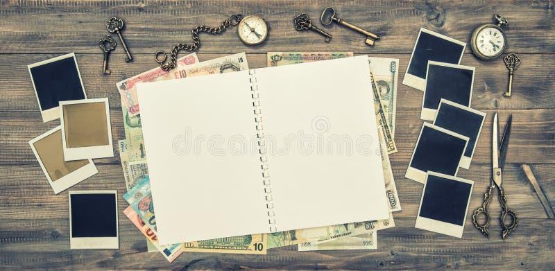 Open travel journal, polaroid photo frames, cash money vintage royalty free stock photos