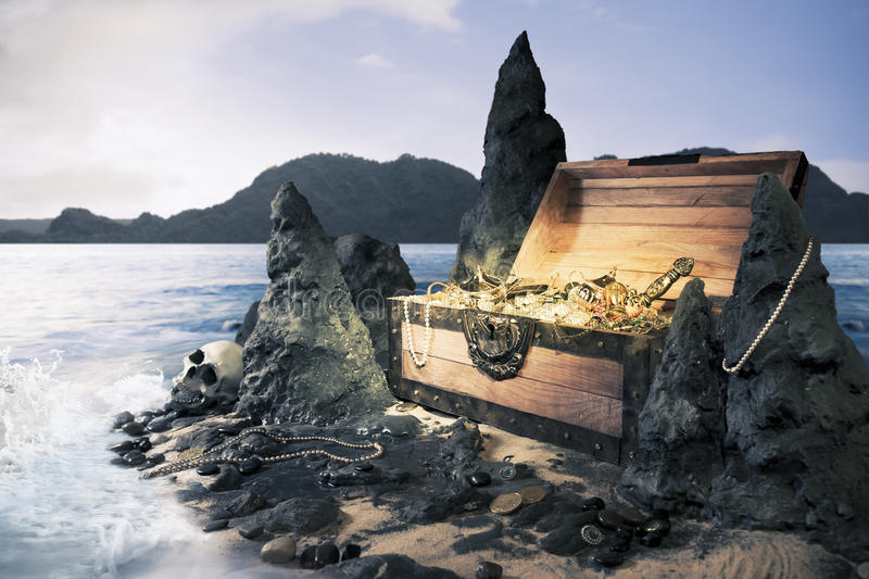 Open treasure chest with bright gold stock photos