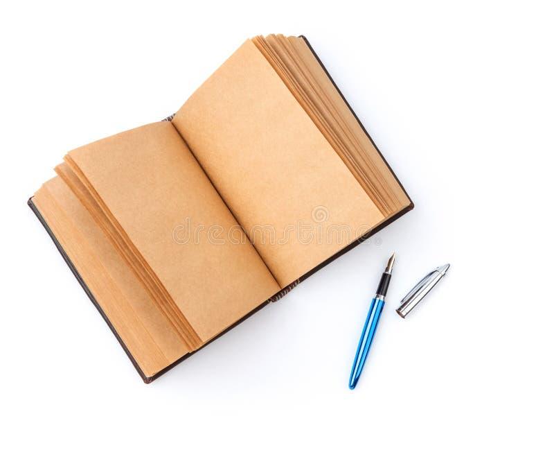 Open uitgespreid oud boek met blanco pagina stock foto