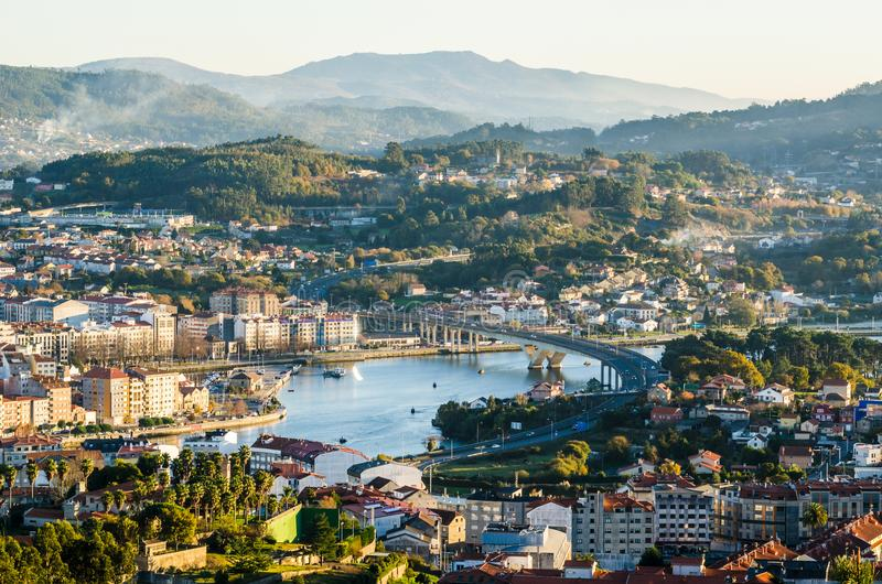 South side of the historical city of Pontevedra from an elevated viewpoint. Highway bridge icwe Lerez river. Open view of the south side of the historical city royalty free stock images