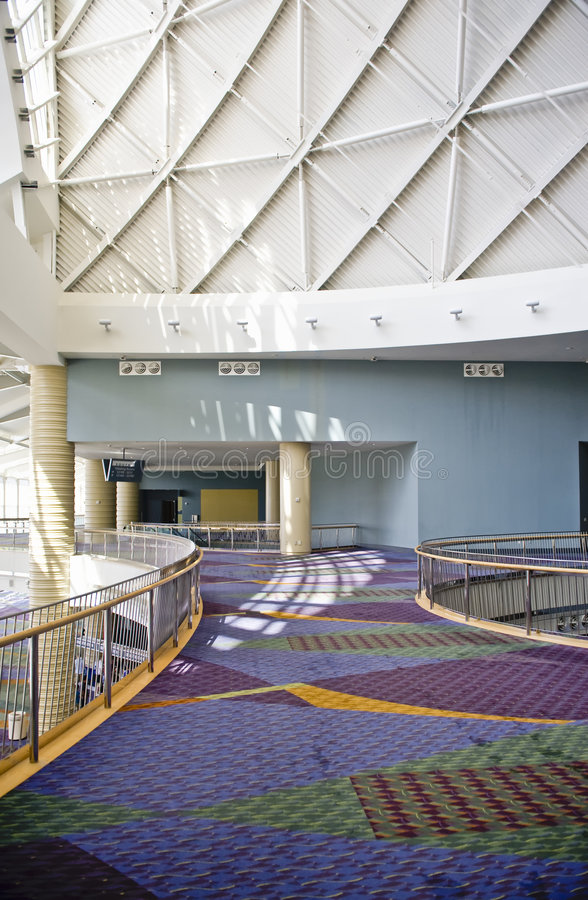 Open walkway in large building. A view of an open walkway with colorful carpeting inside the Orange County Convention Center in Orlando, Florida royalty free stock photos