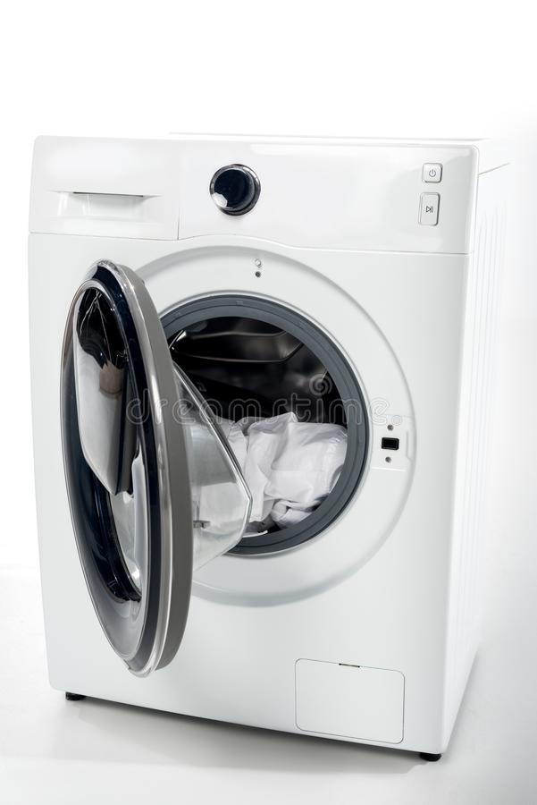 open washing machine with clothes stock photos
