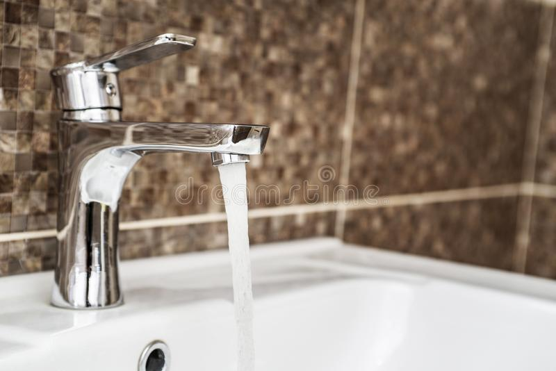Open water tap with running water.  stock image