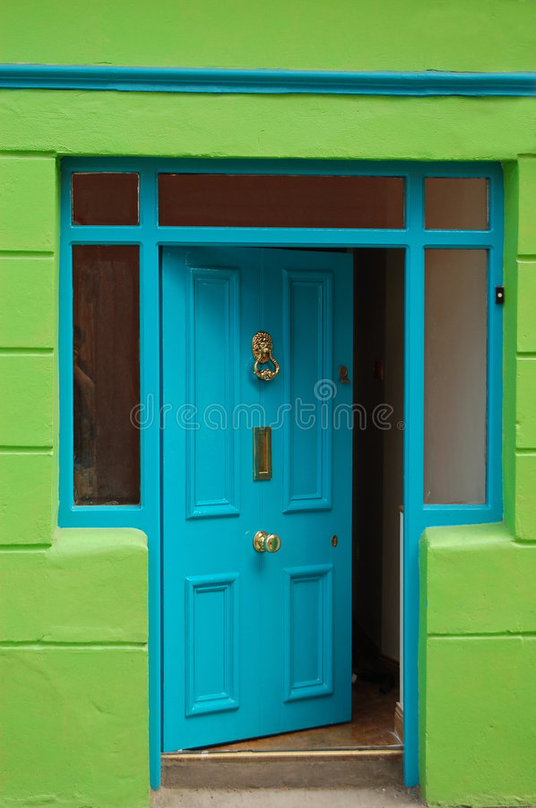 Open welcoming blue door. Happy colors with open welcoming blue door stock image