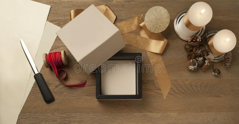 Open white christmas gift box waiting to be packed over a wooden table royalty free stock photography