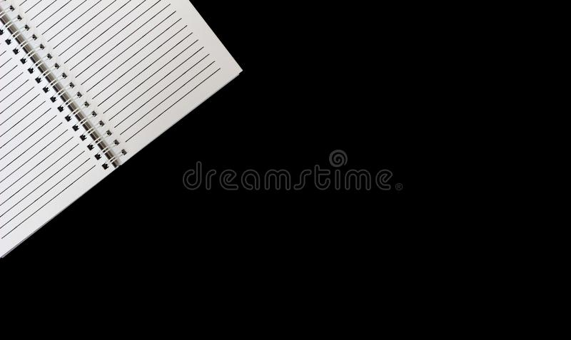 Open white notebook on isolated black background top view. Open white notebook with lining on isolated black background top view royalty free stock photo
