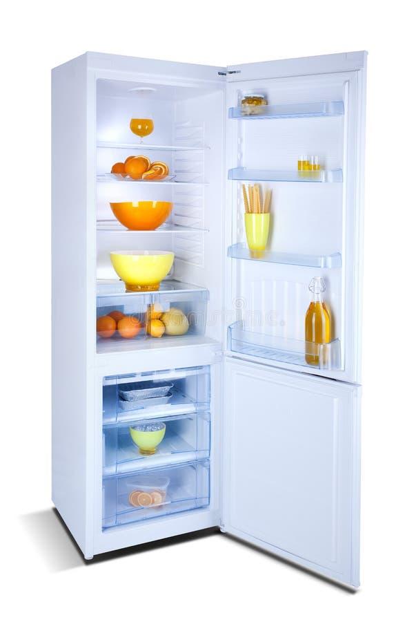 Open white refrigerator. Fridge freezer. Open refrigerator with freezer, shiny white, steel, isolated on white, with fresh food. Isolated on white royalty free stock photos