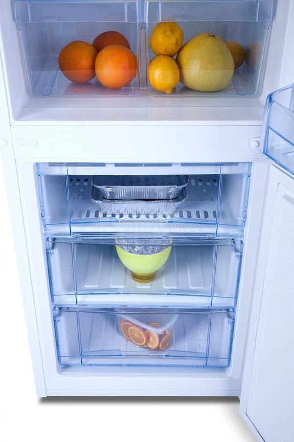 Open white refrigerator. Fridge freezer stock photo