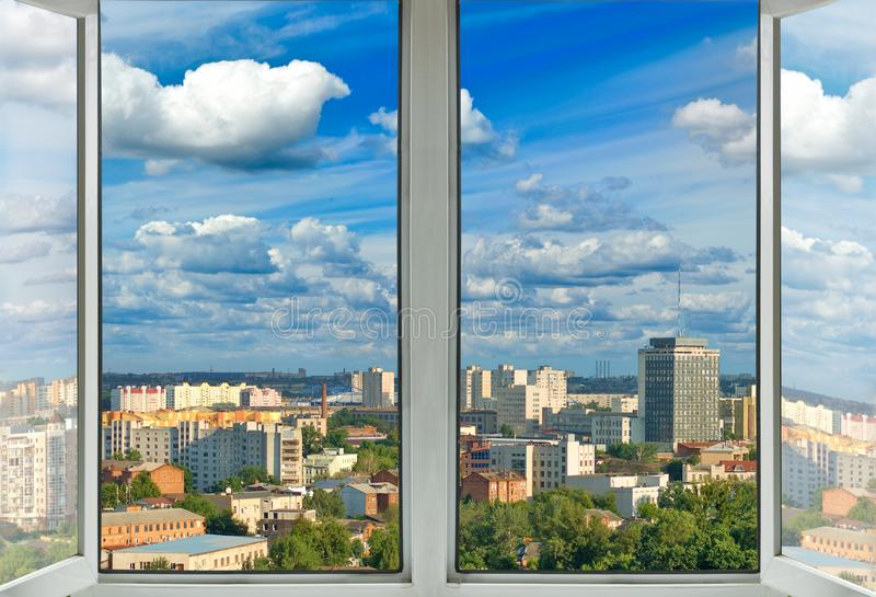 Open window with city view. Close-up royalty free stock images