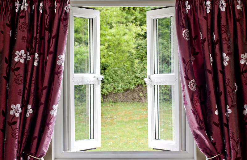 Open Window Draped In Curtains Stock Image