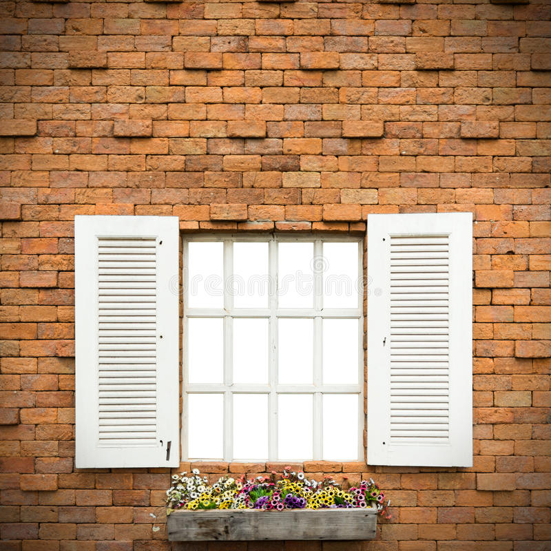 Open Window With Flower Basket On Brick Wall stock photos