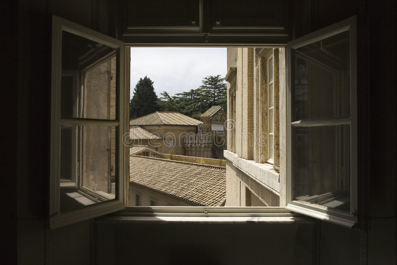 Open window in the Vatican Museum. Looking out open window with view of rooftops in the Vatican Museum, Rome, Italy stock photography