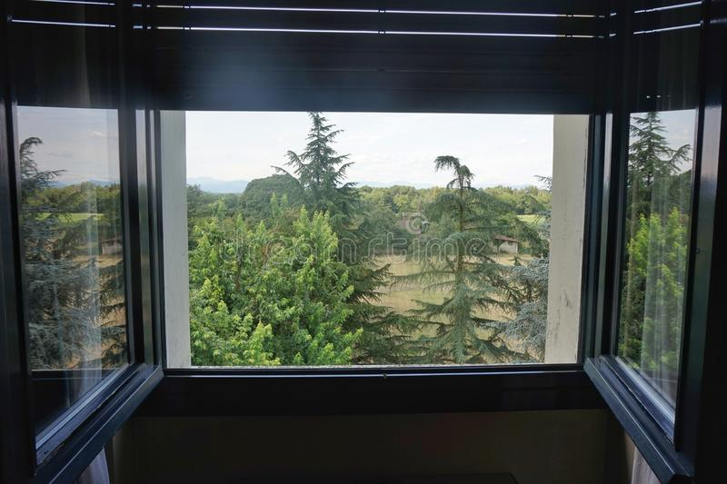 Open window with a view of the mountains. Open window with a view of the mountains royalty free stock photography