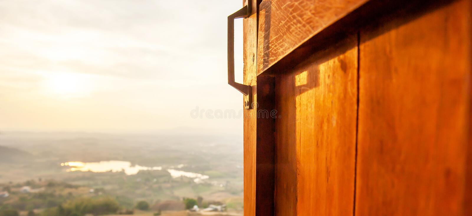 Open window view onto a tranquil morning with the sun shines on a lake in background. Open window view onto a tranquil morning with the sun shines on a lake stock image
