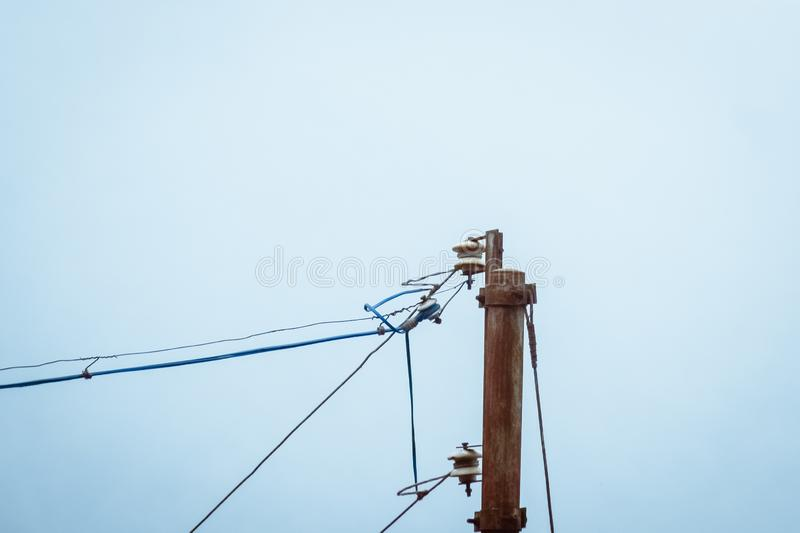 Open wires on lamp posts a major hazard due to poor wiring can increase chance of fire. Causes accidents due to electric shock to. Electrician and birds after a stock image