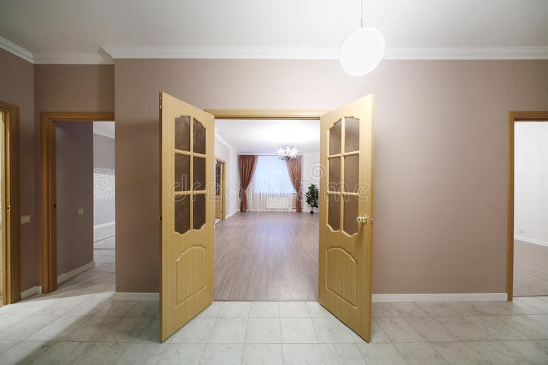 Open wooden doors leading into spacious room royalty free stock images