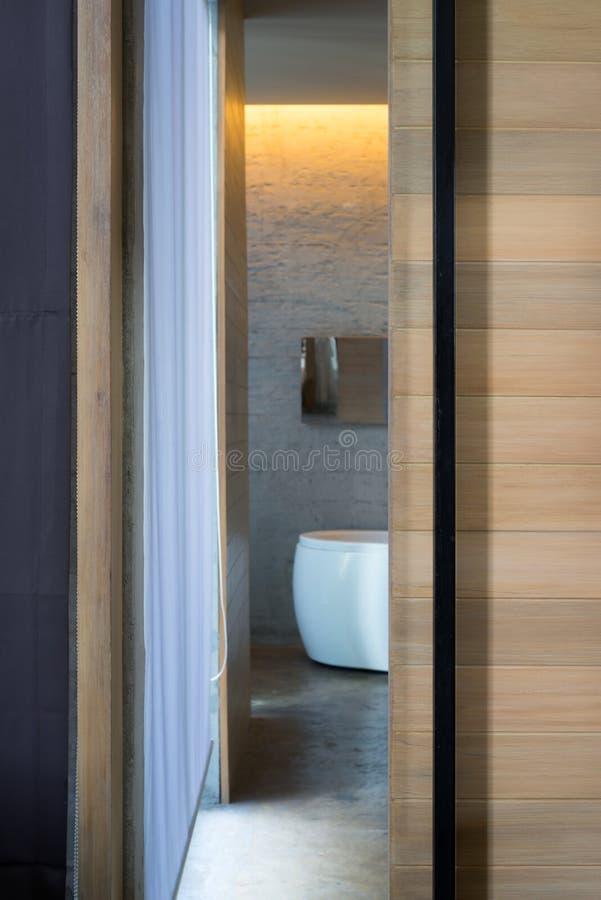 open wooden sliding bathroom door shot vertically stock