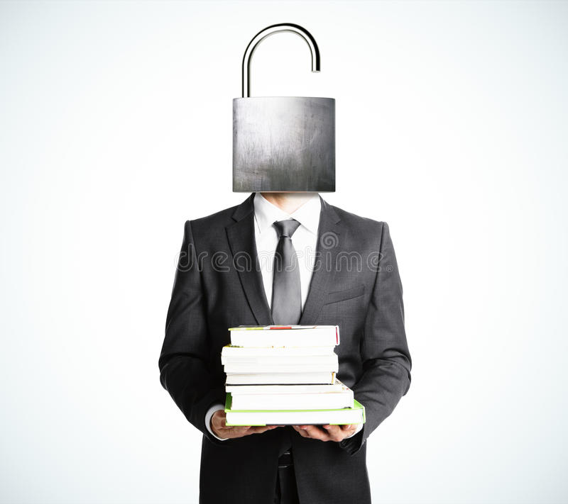 Open your mind concept with businessman with books stock photo