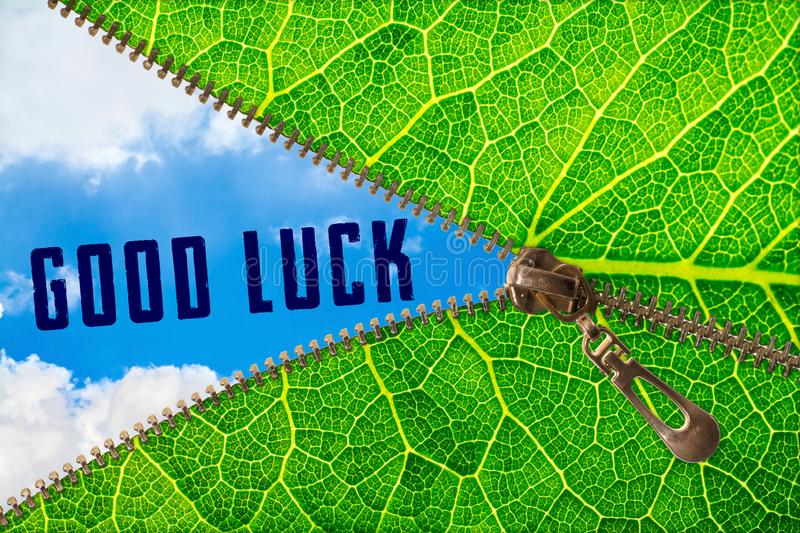 Good luck word under zipper leaf. Open zipper leaf and showing sky with good luck word royalty free stock images