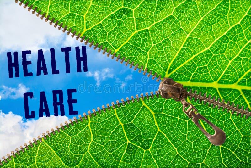 Health care word under zipper leaf. Open zipper leaf and showing sky with health care word stock photos