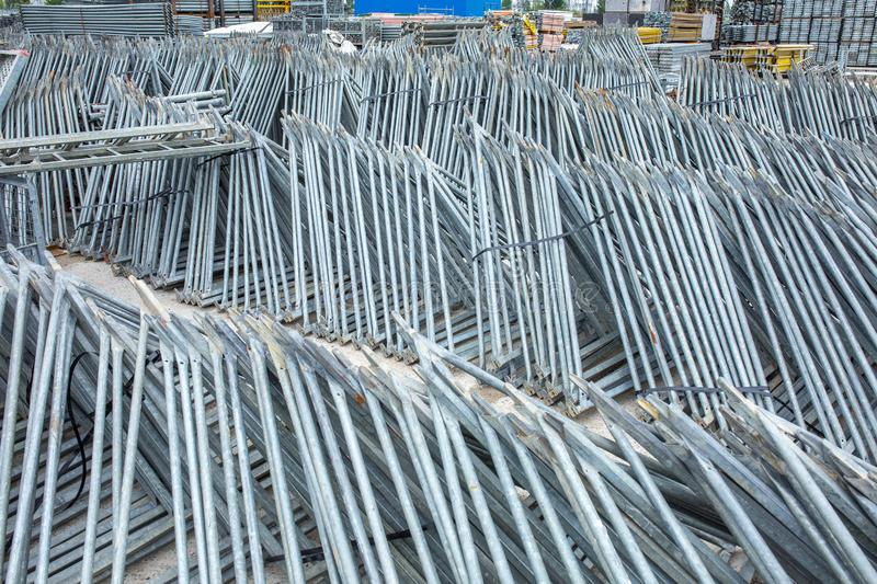 Openair storage of galvanized steel and aluminum frames, ladders, and ringlock scaffolding systems for many applications on. Restoration, industrial and stock image