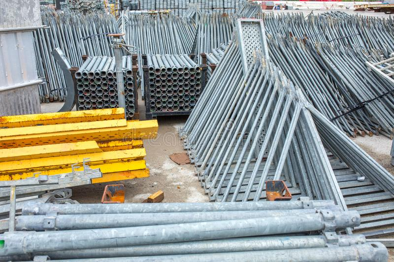 Openair storage of galvanized steel and aluminum frames, ladders, and ringlock scaffolding systems for many applications on. Restoration, industrial and royalty free stock photography