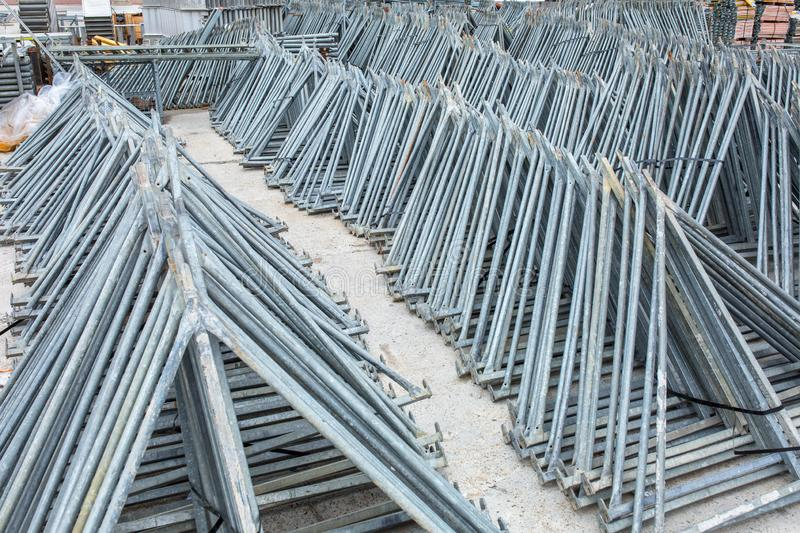 Openair storage of galvanized steel and aluminum frames, ladders, and ringlock scaffolding systems for many applications on. Restoration, industrial and royalty free stock images