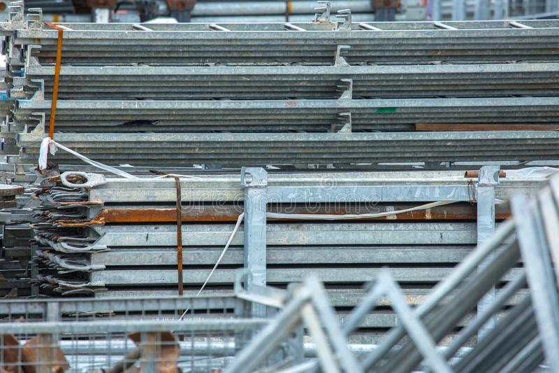 Openair storage of galvanized steel and aluminum frames, ladders, and ringlock scaffolding systems for many applications on. Restoration, industrial and stock photos