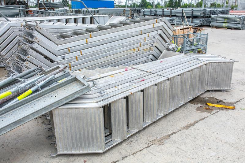Openair storage of galvanized steel and aluminum frames, ladders, and ringlock scaffolding systems for many applications on. Restoration, industrial and stock photography