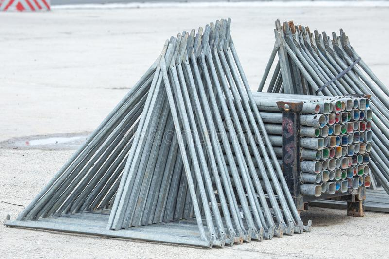 Openair storage of galvanized steel and aluminum frames, ladders, and ringlock scaffolding systems for many applications on. Restoration, industrial and stock images