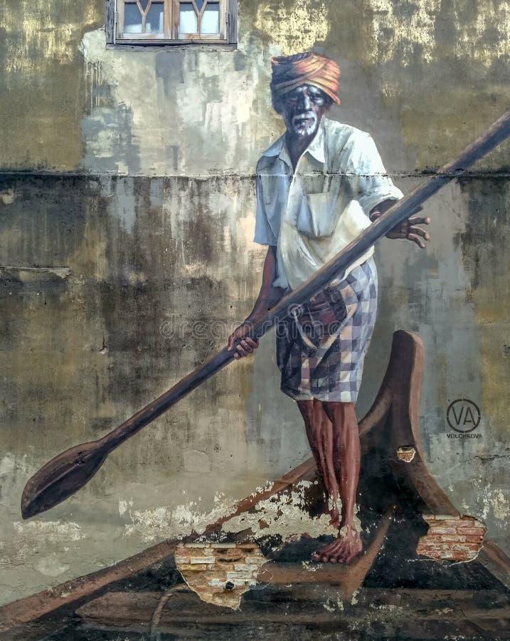 Openbare straatkunst in Georgetown 'Oude mens met een peddel op een boot ', Penang, Maleisië royalty-vrije stock foto's