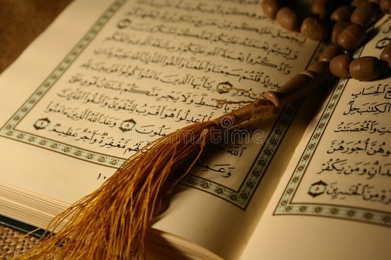 Opend holy book & rosary. Holy book of koran & rosary stock photography