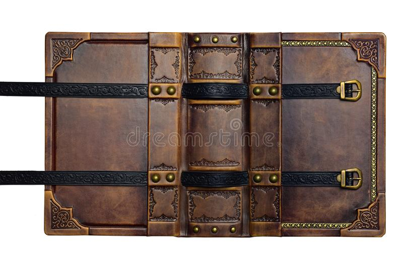 Opened aged brown leather cover with gilded frame and embossed leather stripes royalty free stock image