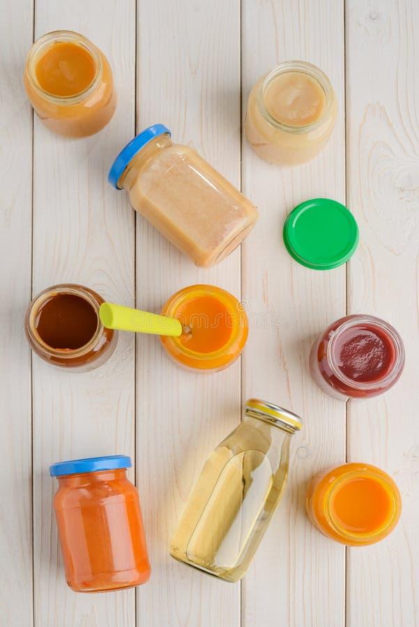 Opened baby food jars royalty free stock photo