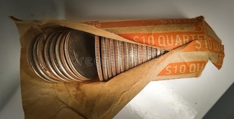 Opened bank packet of loose stacked bronze coins stock images