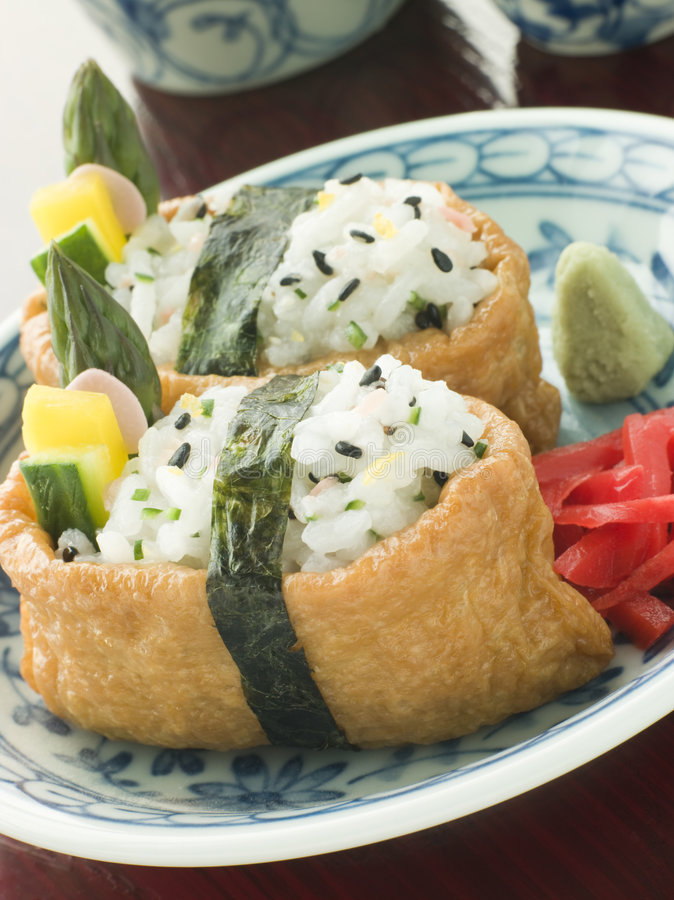Opened Bean curd Pouches with Citrus Sushi Rice Ve stock photo