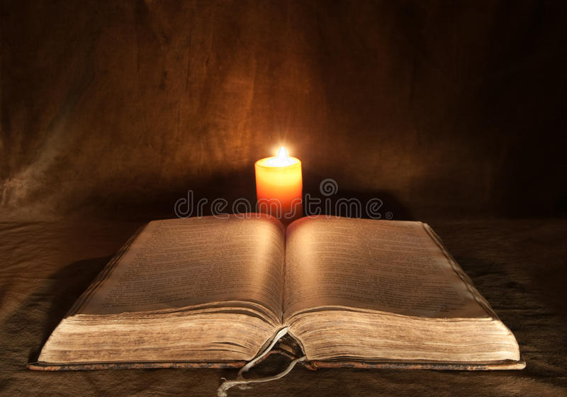 Opened Bible and Candle stock photos