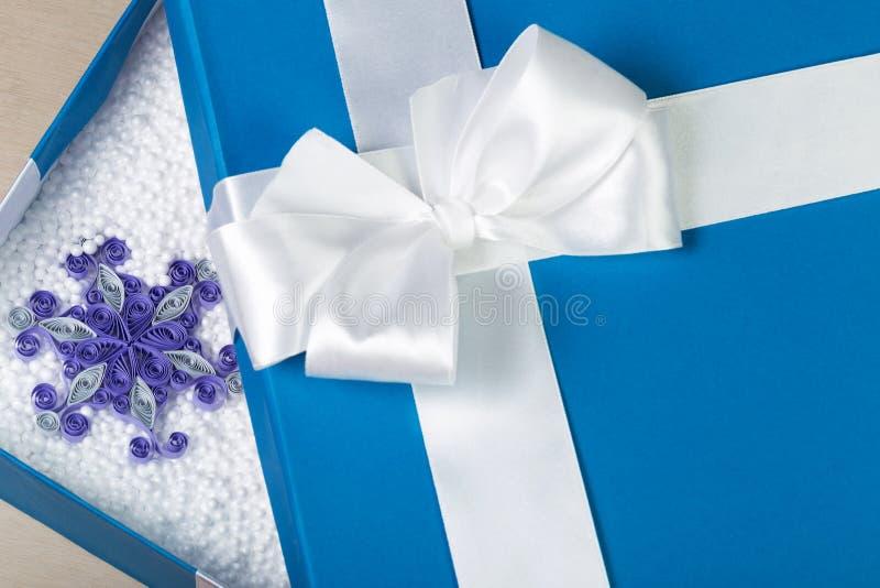 Opened blue box filled with white styrofoam balls. Beautiful pap royalty free stock photo