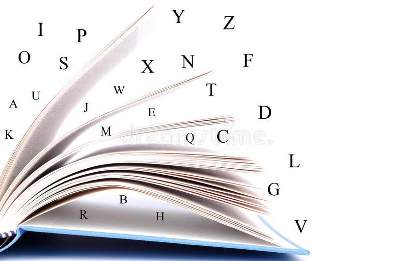 Opened book. With alphabet letters on white background royalty free stock images