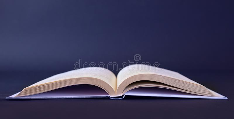 Opened book on blank table stock photography