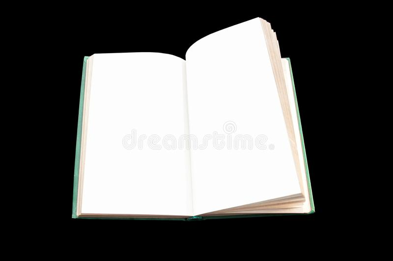 Opened book close-up on a black background. royalty free stock image